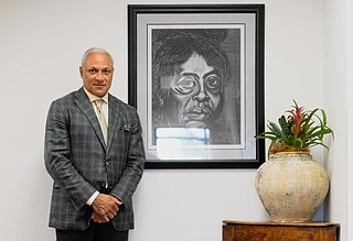 Mike Espy gave the Jackson Free Press a tour of his work office in 2018, where hangs a portrait of historic Mississippi civil rights leader Fannie Lou Hamer—one of his personal heroes. Photo by Ashton Pittman