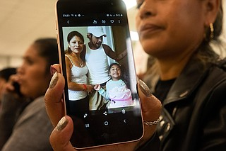 Hilda (last name withheld) shares a photograph of herself with her husband, Antonio, and daughter. Antonio remains in ICE custody, without a bond hearing, following the Aug. 7 raids in Mississippi. Photo by Seyma Bayram