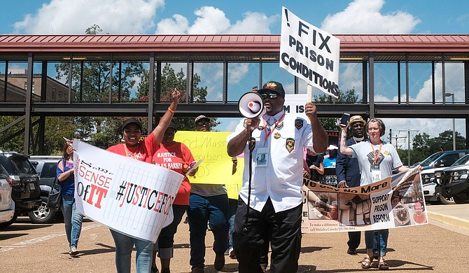 At a mass incarceration rally in Brandon, Miss., on July 29, family, friends and community members marched to end practices that they say incarcerate far too many people for far too long, often for nonviolent crimes.  Photo by Ashton Pittman.