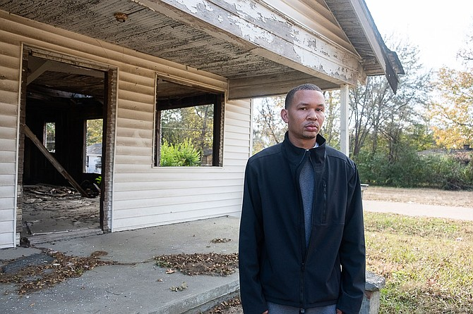 Terun Moore stands outside an abandoned house in the Washington Addition, one of three Jackson neighborhoods where a new credible-messenger and violence-interruption program aims to counsel residents at risk of committing violence. Photo by Seyma Bayram