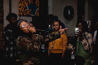 Rapper Unknwn performs for the first time at the 4th Quarter Exchange, a music event that brings artists and consumers face-to-face through performances and networking. Photo by Drew Dempsey