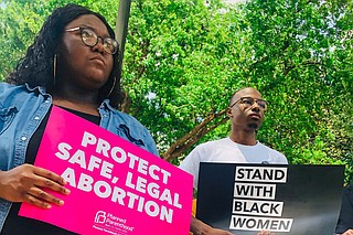 Abortion-rights activists protested against Mississippi's six-week abortion ban outside the Mississippi Capitol building in May 2019. Photo by Ashton Pittman