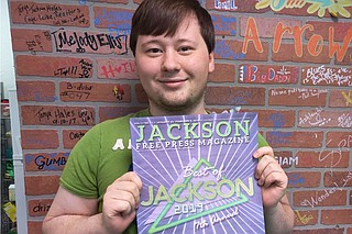 Deputy Editor Nate Schumann holds a copy of last year's Best of Jackson issue, which was the first issue he helped put together when he first first joined the JFP as an assistant editor under then-managing editor Amber Helsel. Photo by Nick Judin