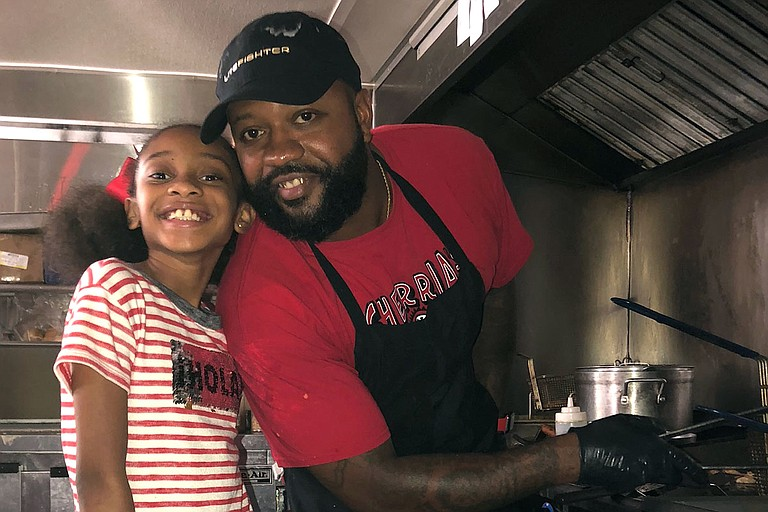 Chef Willie Williams Jr., teaches his daughter Willow the ropes of cooking. Photo courtesy Willie Williams