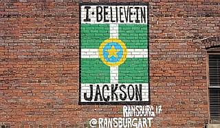 "Local artist Justin Ransburg's ""I Believe in Jackson"" art piece hidden is plain sight off East Capitol Street. Azia Wiggins believes in it, too. Photo by Azia Wiggins"