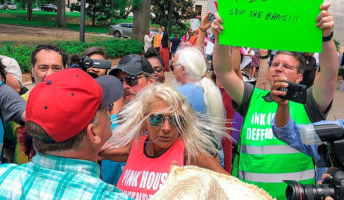 An abortion-rights rally outside the Mississippi Capitol building last year drew a moment of chaos when an anti-abortion activist with a bullhorn interrupted a speech. Photo by Ashton Pittman