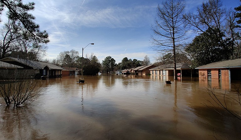 The Pearl River flood affects over 500 homes in the Greater Jackson area, driving residents from their homes for what may be a long evacuation. Emergency responders stressed the danger of even low flood waters. Photo by Nick Judin