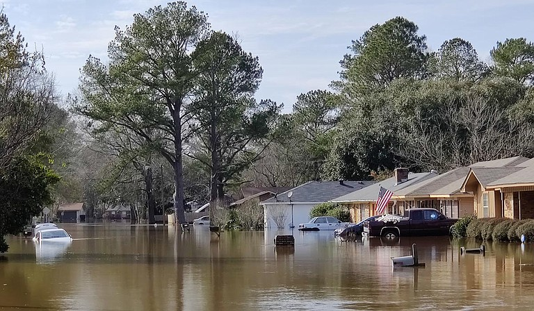 """Miles from historic flooding along the Pearl River, west Jackson residents gathered for an update on last month's flash floods. Public officials provided a bevy of potential solutions—and pitched the """"One Lake"""" plan while they were there. Photo by Nick Judin"""