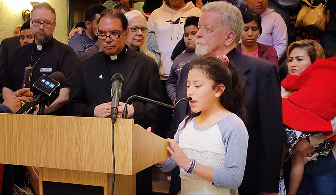 Immigrants and activists like Floribeth Lopez, 11, took to the Capitol last week, imploring legislators and the public to uphold the right of undocumented residents and to reject laws that target them. Photo by Nick Judin