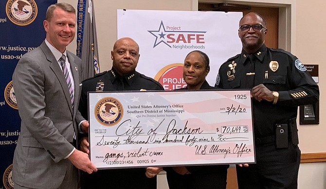 """On March 2, 2020, U.S. Attorney for the Southern District of Mississippi Mike Hurst tweeted this photo showing Jackson Police Chief James E. Davis accepting a $70,649 grant check on behalf of the City of Jackson. Hurst's tweet stated that the City had received the grant under ProjectEJECT """"to combat gangs & violent crime in our Capital City."""" Photo courtesy Mike Hurst Twitter"""