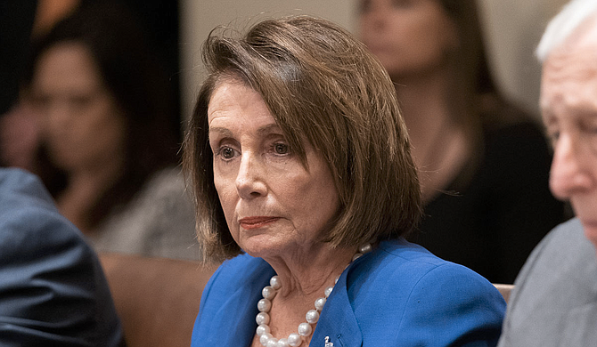 """House Speaker Nancy Pelosi, D-Calif., swung behind the bipartisan agreement, saying it """"takes us a long way down the road in meeting the needs of the American people."""" The measure is set for House passage on Friday and President Donald Trump's immediate signature. Official White House Photo by Shealah Craighead"""