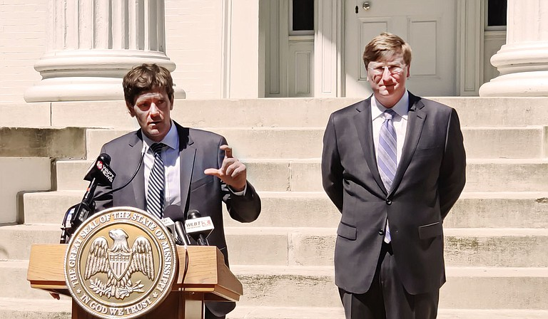 """Mississippi State Health Officer Dr. Thomas Dobbs laid out specifics of his new strategy for addressing COVID-19 at a March 26 press conference in front of the governor's mansion, using the successful South Korea model as an example. Gov. Tate Reeves later issued an addendum confirming his previous executive order's policy on local measures that impede """"essential"""" businesses. Photo by Nick Judin"""