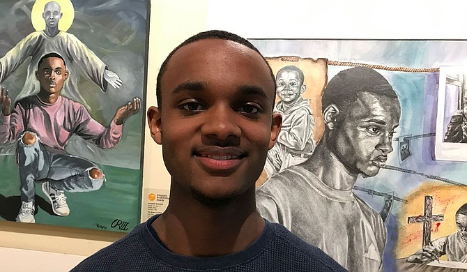 Murrah High School senior Charles Rounds stands with some of his artworks at a recent exhibition held at the Mississippi Museum of Art. Photo courtesy Sherry Lucas