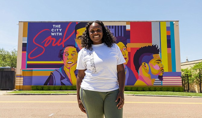 "This year's cover art, titled ""JXN Icons,"" depicts four notable Jacksonians: Civil Rights leader and NAACP Field Officer Medgar Evers; writer and photographer Eudora Welty; USA IBC founder and American ballet dancer Thalia Mara; and musician and philanthropist David Banner. Reshonda Perryman (pictured), Visit Jackson's Creative Design Manager, created the cover image. Photo courtesy Visit Jackson/Tate Nations"