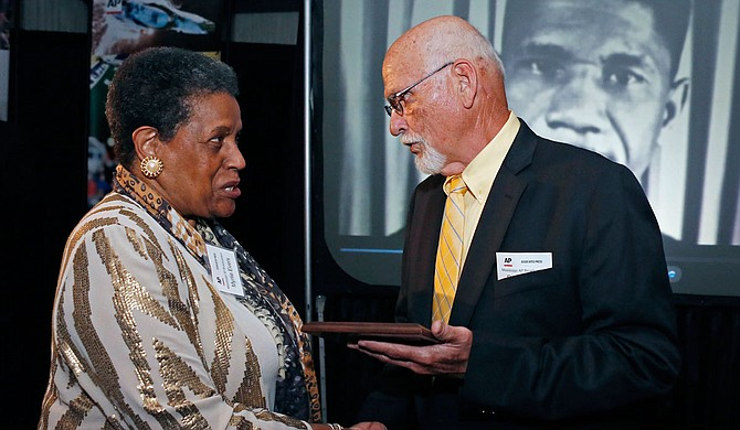 """""""In this April 26, 2014 file photo, Myrlie Evers-Williams, widow of the murdered Mississippi civil rights leader Medgar Evers, receives the 2014 Mississippi Associated Press Broadcasters Pioneers of Television award from retired Jackson, Miss., bureau Associated Press news editor Ron Harrist in Jackson, Miss. Harrist has died at the age of 77 of complications from leukemia. The Mississippi journalist had a four-decade career with the AP, covering Elvis Presley, black separatists, white supremacists and college football legends over the years. (AP Photo/Rogelio V. Solis, File)"""""""
