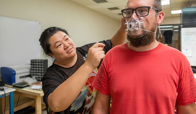 Anna Wan, mathematics professor at USM, used a 3-D printer to make 250 respirator masks for medical professionals in the Pine Belt who are treating COVID-19 patients. Photo courtesy USM