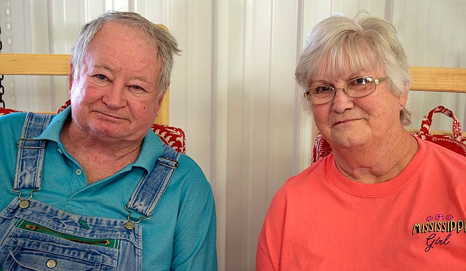 Doris Berry's son John and his wife Brenda rest in rocking chairs at the family-owned farmers market. Photo by Michele D. Baker