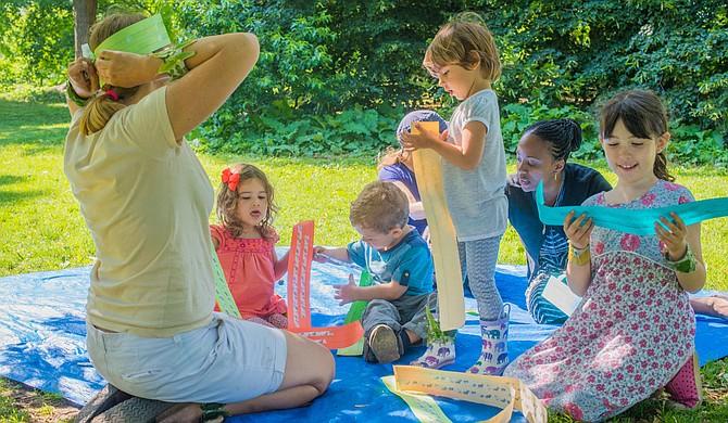 The Tinkergarten program teaches children life skills through interacting with nature. Photo courtesy Kristina Gibb Photography