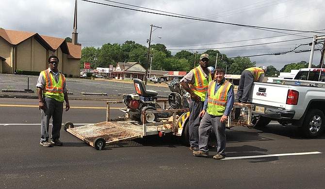 A road construction crew works on historic Robinson Road in late May. Photo by Kayode Crown
