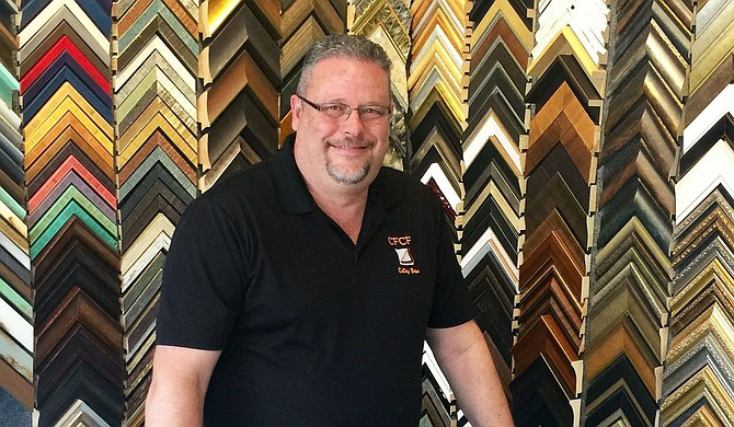 Calby Boss, owner of Calby's Fine Custom Framing in Flowood, offers specialized framing, art and photograph restoration, mirror repair and more. Photo courtesy Calby Boss