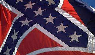 "Novelist Michael Farris Smith writes that Mississippi officials should change the Mississippi flag immediately as the nation reckons with systemic racism and history. ""It's offensive, and it's embarrassing, and it continues to make Mississippi look like it lives on the back end of civilization. Enough,"" he writes. Photo courtesy Flickr/Stuart Seeger"