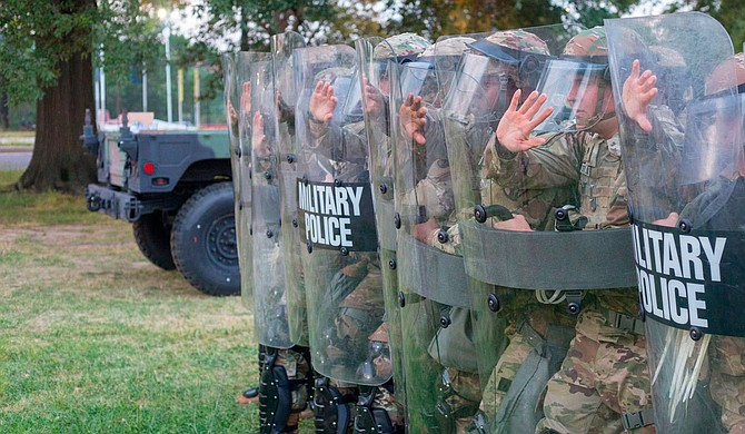 Soldiers with the Mississippi Army National Guard train on counter-riot tactics at the Joint Force Headquarters in Washington, D.C., on June 3, 2020. The Guardsmen are part of Task Force Magnolia, the Mississippi National Guard's response to civil unrest throughout the country. U.S. Army National Guard Photos by Spc. Jovi Prevot
