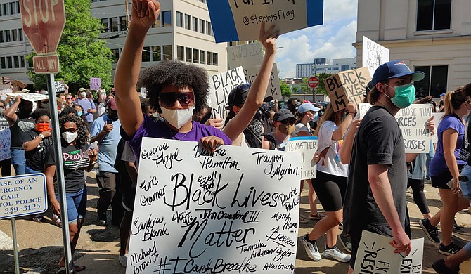 A protester at the June 6, 2020, Black Lives Matter rally in downtown Jackson holds a sign emblazoned with the names of some of the many police-violence victims in America in recent years. Photo by Nick Judin