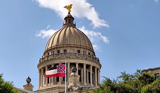 """Joshua D. Dedmond and M. Endesha Juakali of Cooperation Jackson write that the Mississippi state flag """"represents a time when most people of African descent were bound in chattel slavery and could be sold like cattle and bred like dogs."""" Photo by Nick Judin"""