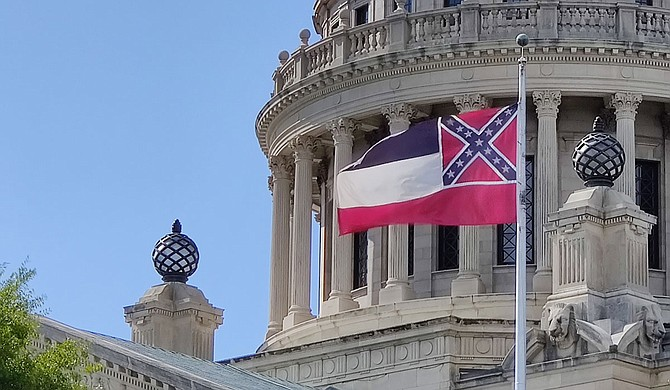 The Southeastern Conference is considering barring league championship events in Mississippi unless the state changes its Confederate-based flag. Photo by Nick Judin