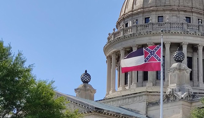 The Hinds County Democratic Executive Committee is calling upon Gov. Tate Reeves, Lieutenant Gov. Delbert Hosemann, and the Mississippi Legislature to immediately halt the use of white supremacist, Confederate symbolism on the official state flag. Photo by Nick Judin