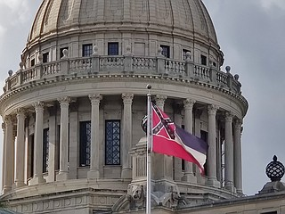 The Mississippi State Flag, with the Confederate battle emblem in its canton, faces its greatest challenge in over 20 years, with passage by the Mississippi House of H.B. 1796, a bill to replace it as the official flag. Photo by Nick Judin