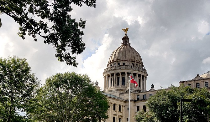 Mississippi will have a new state flag without Confederate symbolism after a legislative supermajority voted to retire the 1894 design. The old state flag flew for the last time above the Capitol on Sunday, now consigned to history with the Confederacy it once honored. Photo by Nick Judin