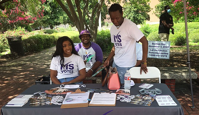 Members of Mississippi Votes set up a stand at a voter-registration event June 28 at Jackson City Hall. Photo by Kayode Crown