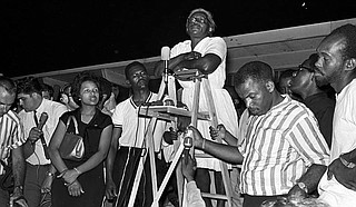 "Activist Flonzie Brown Wright, left, and John Lewis, right (holding ladder), listen as Annie Devine, known as the ""Mother of the Movement,"" stands on the ladder addressing a huge crowd of marchers from across the country in Canton, Miss., in support of James Meredith's 1966 March Against Fear. Photo courtesy Alabama Department of Archives and History"