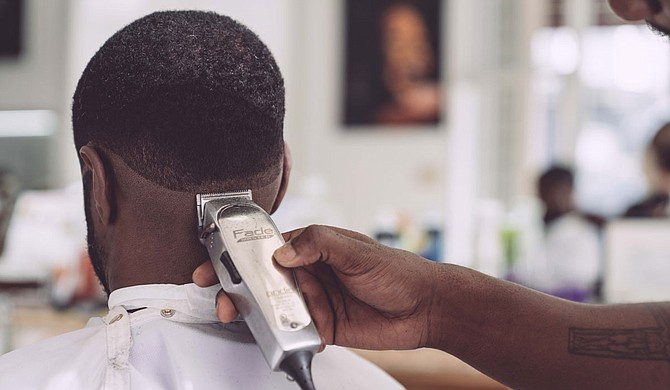 The barber's chair may be the new therapy couch for parts of the South where mental health care is in short supply. Photo by Edgar Chaparro on Unsplash