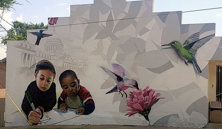 Douglas Panzone created this artwork as part of the Belhaven Heights community mural project. Photo by Azia Wiggins