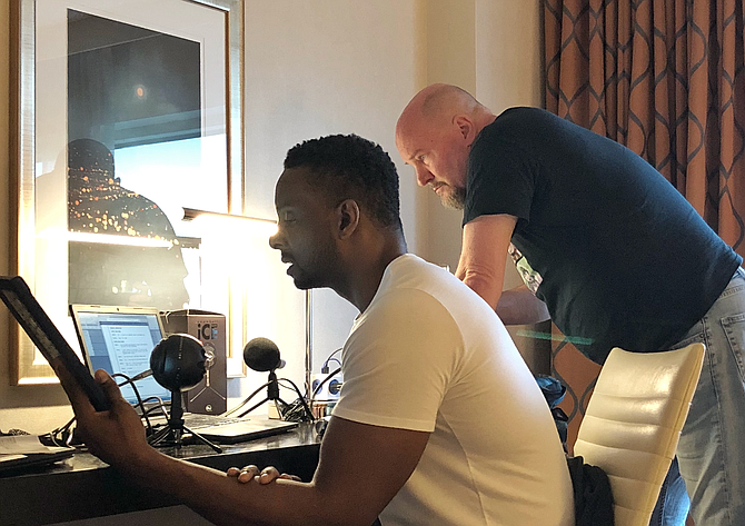 Two of three co-founders for the Discussing Network, Clarence Brown (left) and Lee Shackleford (right), prepare for a podcast. Photo courtesy Kyle Jones