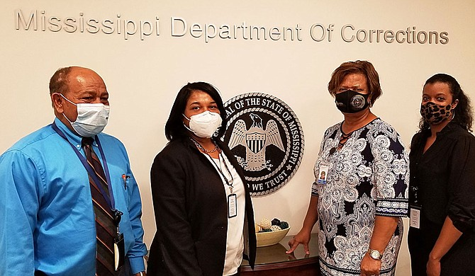 (left to right) Dr. Zein Mohamad, Felicia Graham, Willie Chaffier, and Chanel Delandro. Photo courtesy MDOC