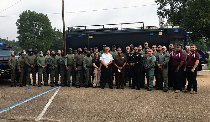 The Jackson-Hinds County special weapons and tactics team members after their swearing-in today. Sheriff Lee Vance pushed for the 33 new SWAT team members. Photo by Kayode Crown