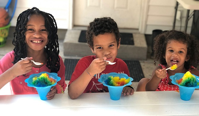 Co-owner Jeremy Harper's children enjoy shaved ice prepared by CrunchTime Concessions. Photo courtesy CrunchTime Concessions