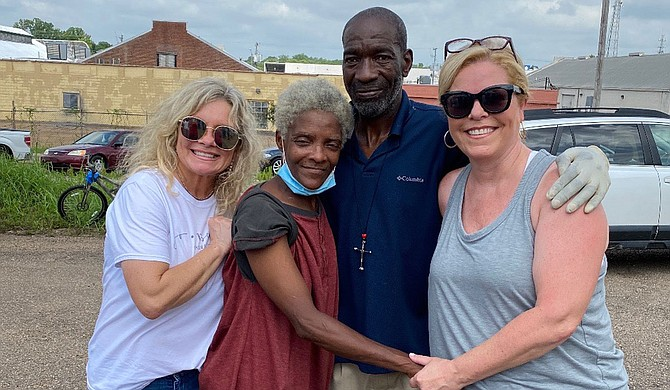 Shower Power founder Teresa Renkenberger (left) and board member Mary Ann Kirby (right)pose with Shower Power Friends, Regana and Jack (center) at the nonprofit's location in downtown Jackson (836 S. Commerce St.), where homeless citizens may shower on Fridays. Photo courtesy Teresa Renkenberger