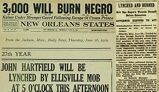 Southern newspapers, including the Jackson Daily News, announced the lynching of John Hartfield in Ellisville before it happened, probably helping increase the crowds that watched and later mailed postcards about his brutal lynching. Hartfield was accused of sexual assault of a white woman, but was offered no due process during the Red Summer of 1919 when white people were murdering and brutalizing Black people across the U.S., as well as burning their homes and businesses. Clippings: Newspapers.com