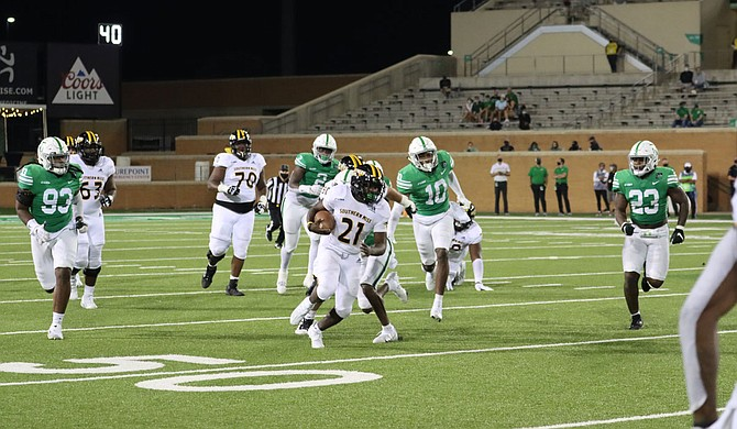 Freshman running back Frank Gore, Jr., the son of NFL running back Frank Gore, led USM in rushing in the game against the University of North Texas—the first win for the Golden Eagles this fall 2020 season. Courtesy USM