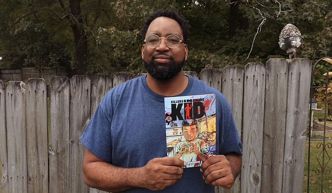"Local artist Christopher Windfield holds a first-edition copy of his debut graphic novel, ""KIDs: Killers in Disguise,"" which released earlier this year and is available on Amazon. Photo courtesy Christopher Windfield"
