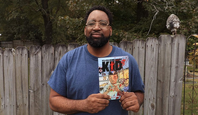 """Local artist Christopher Windfield holds a first-edition copy of his debut graphic novel, """"KIDs: Killers in Disguise,"""" which released earlier this year and is available on Amazon. Photo courtesy Christopher Windfield"""