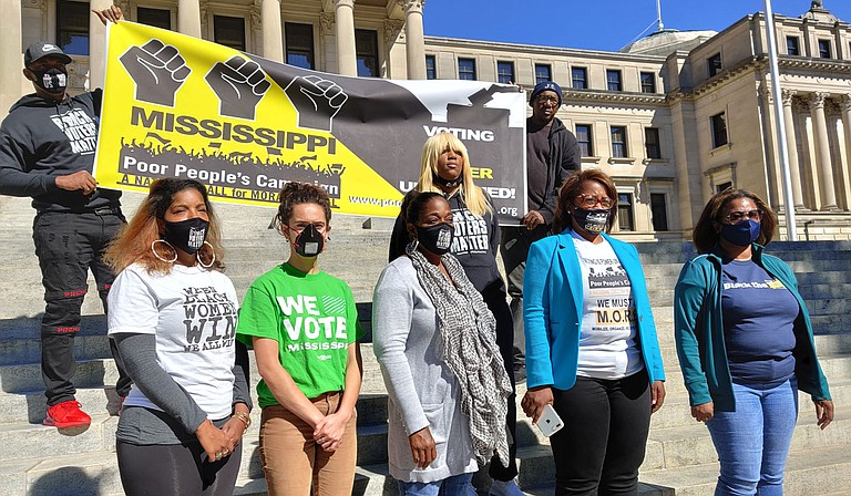 Representatives from several grassroots organizations, including the Mississippi Poor People's Campaign, held an event on the steps of the State Capitol today, castigating state officials for sudden polling place changes. From left, Rukia Lumumba, Miranda, a Hinds County resident, Sharon Brown, Danyelle Holmes, Nsombi Lambright. Photo by Nick Judin