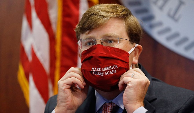 """""""Gov. Tate Reeves has done precisely the wrong things to quell this virus. He could have led his party and supporters in Mississippi instead of sheepishly kowtowing to the extremists."""" Photo by Rogelio V. Solis via AP"""