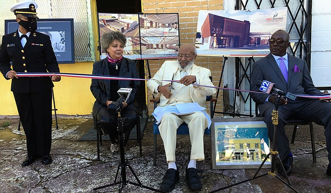 Civil-rights icon James Meredith, flanked by his wife, Judy Alsobrooks Meredith, and an associate, prepares to cut the ribbon for his proposed museum and Bible society headquarters Wednesday. Photo by Kayode Crown