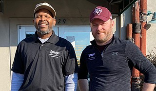 For the last six years, Chris Jefferson (left) and Chris Carter (right) have owned and operated Scrooge's, which will be open on Christmas Day. Photo courtesy Scrooge's