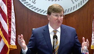 On the same day that saw 2,457 new COVID cases, Gov. Tate Reeves told reporter Nick Judin he was wrong that it was a new peak. In fact, Reeves was wrong. Photo courtesy State of Mississippi